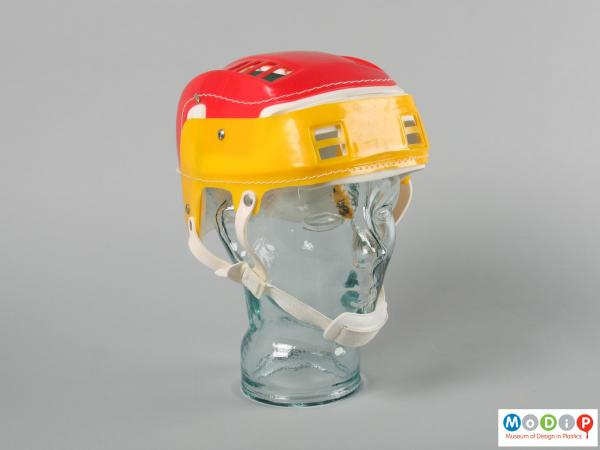 Front view of a helmet showing the chin strap.