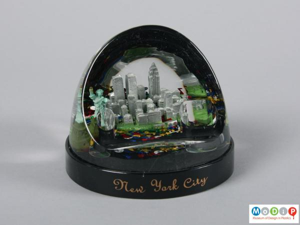 Front view of a snow globe showing the New York cityscape.