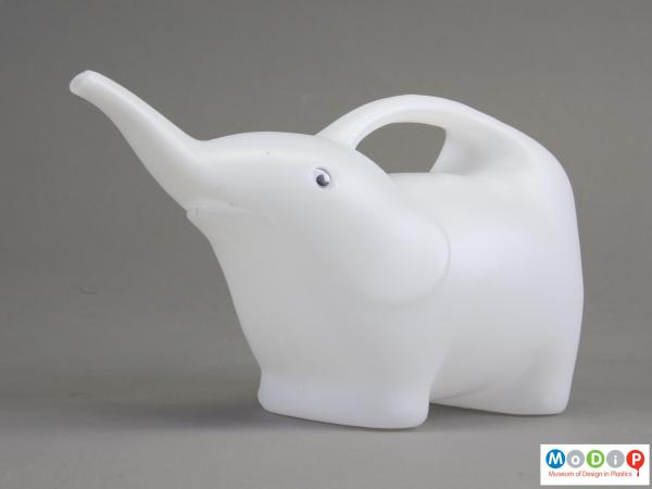 Side view of a watering can showing the elephant shape.