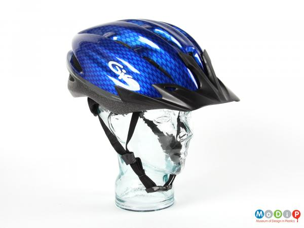 Side view of a Giro helmet showing the peak at the front.