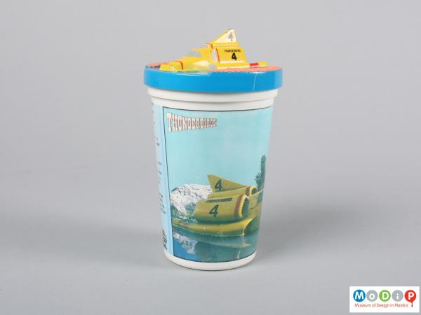 Side view of a beaker showing the moulded vehicle on the lid.