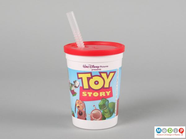 Side view of a Toy Story beaker showing the printed illustration running around the outside.