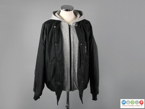 Front view of a jacket showing the contrasting central / hood fabric and that of the main body.