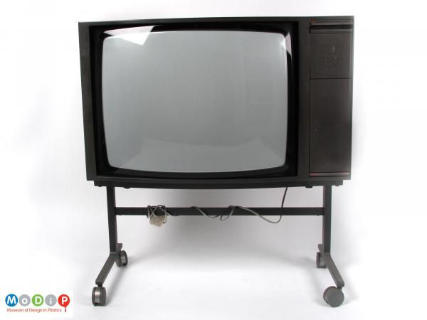 Front view of a Bang and Olufsen TV showing the square screen with controll panel on one side.