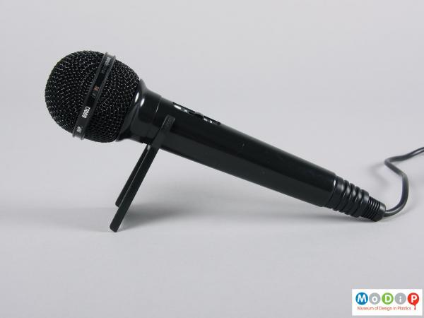 Side view of a microphone showing it on the small stand.