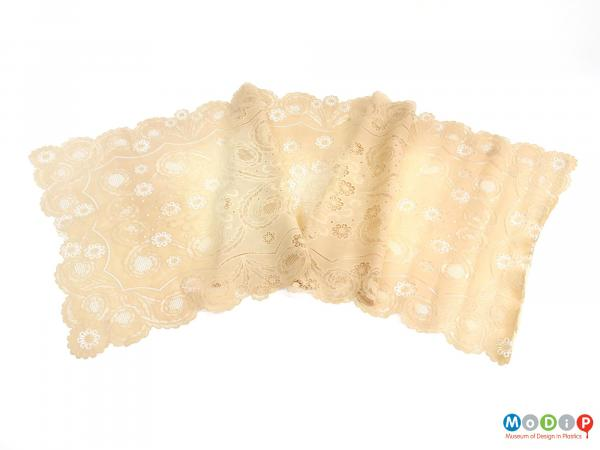 Top view of a table runner showing the lace effect.