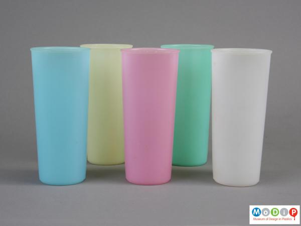 Side view of a group of 5 beakers showing the tall slender shape.