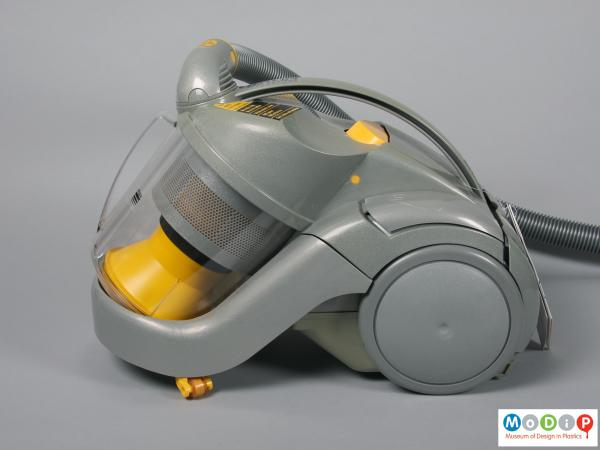 Side view of a vacuum cleaner showing the clear bin.