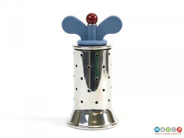 Side view of a pepper grinder showing the wing nut turnng handle.