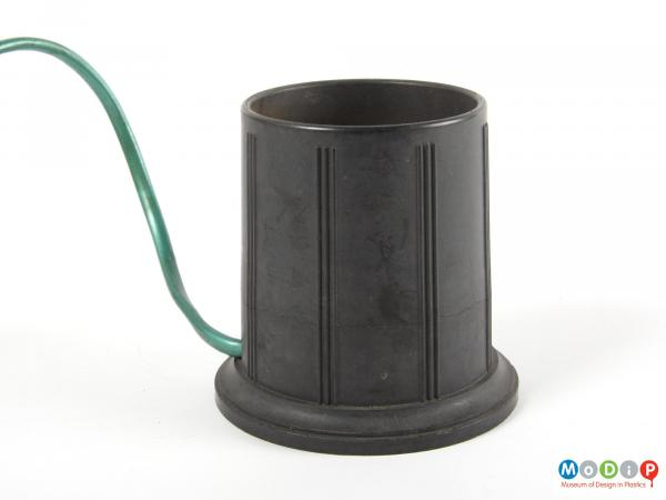 Side view of a bottle warmer showing the moulded line decoration.