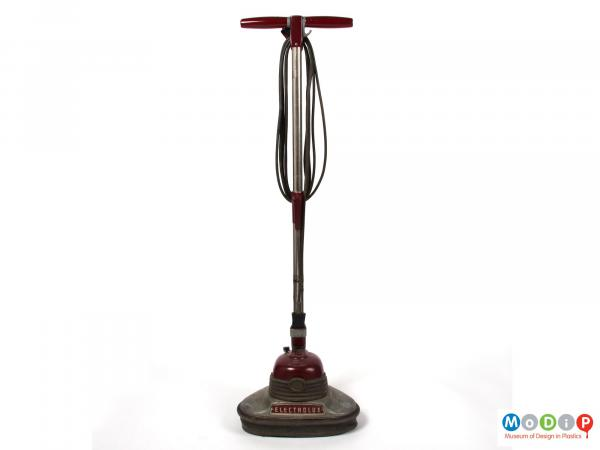 Front view of an Electrolux floor polisher showing the cable coiled and hanging on specific hooks.