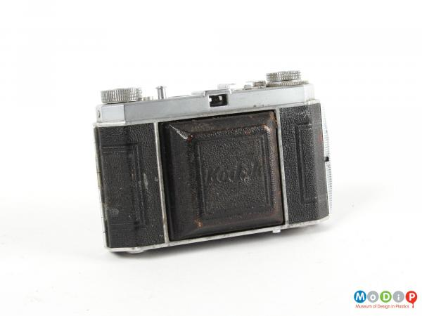 Frontview of a camera showing the lens cover closed.