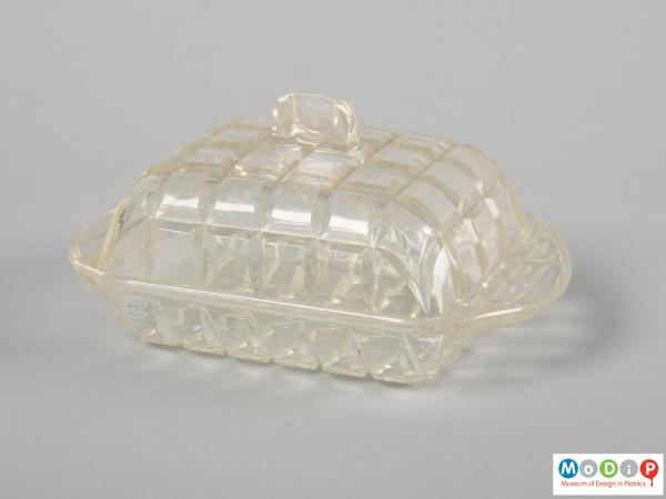 Side view of a butter dish showing the curved shape.