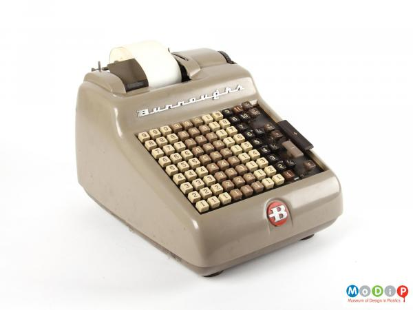 Side view of a Burroughs Adding Machine showing the metal body and plastic keys.