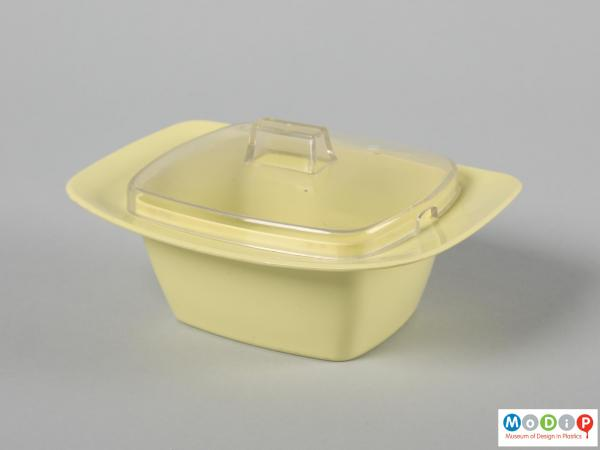 Side view of a butter dish showing the elongated shape.