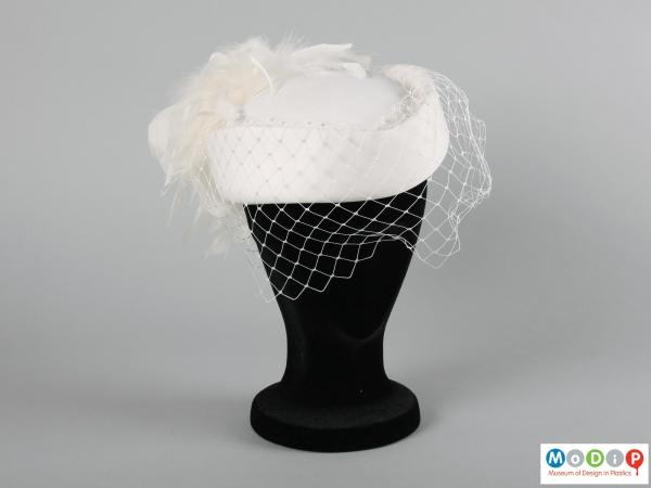 Front view of a hat showing the net veil.