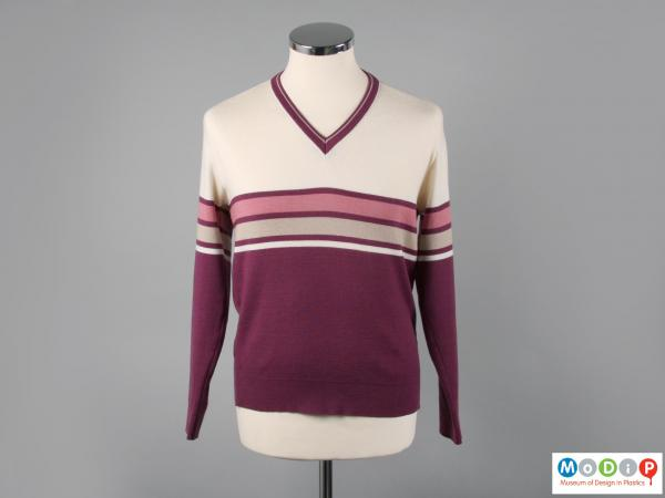 Front view of a sporting jumper showing the v-shaped neckline.