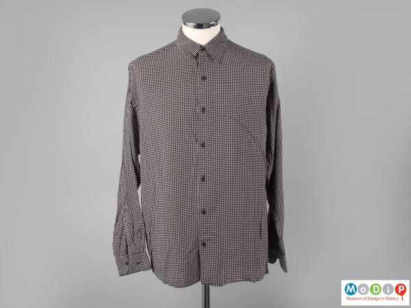 Front view of a shirt showing the long sleeves and small collar.