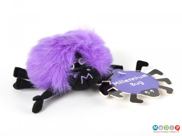 Front view of a Millennium Bug showing the face of the creature and the original swing tag.