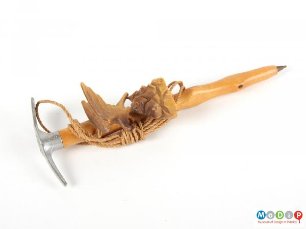 Side view of an eagle and axe head pen showing the eagle model on a rock.