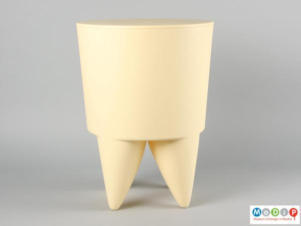 Side view of a BuBu 1er stool showing the straight-sided top section and the curved legs below.
