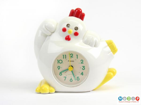 Front view of an alarm clock showing the rooster's wings, feet and tail.
