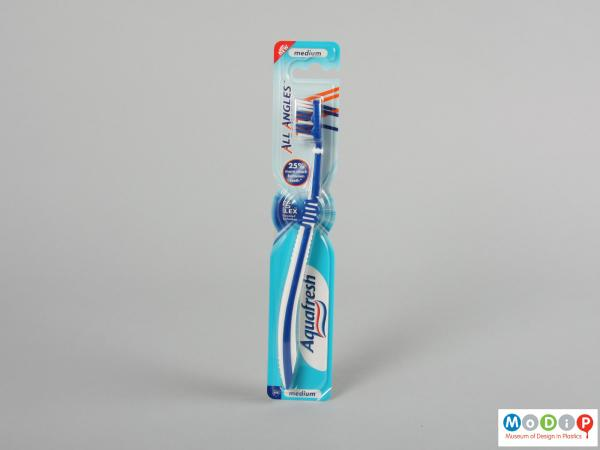 Front view of a toothbrush showing the flexible handle.