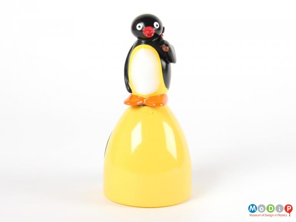Front view of a Pingu sweet container showing the penguin standing on top of a yellow mound.
