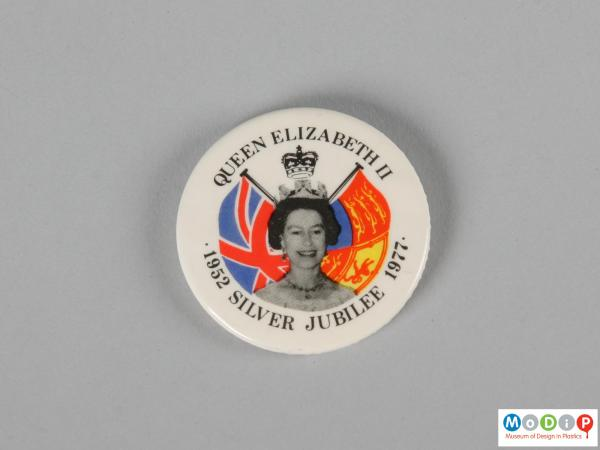Front view of a pin badge showing the printed design.