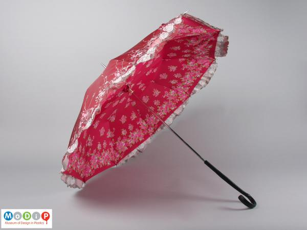 Side view of an umbrella showing the canopy.