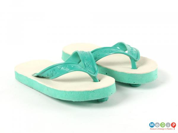 Front view of a pair of flip flops showing the foot straps.