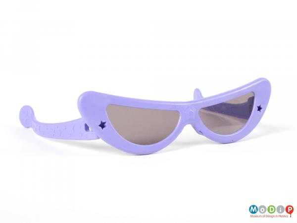 Front view of a pair of sunglasses showing curved lenses.