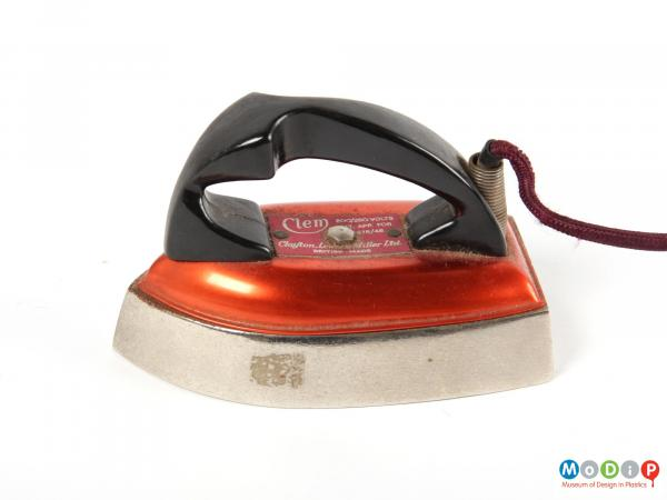 Side view of an iron showing the lrage curved handle.