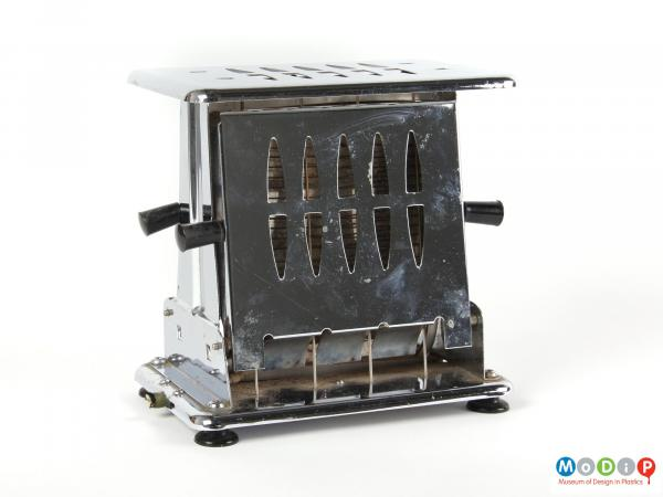 Side view of a Kenwood toaster showingthe flat top and sides with vents in to allow any steam to escape.