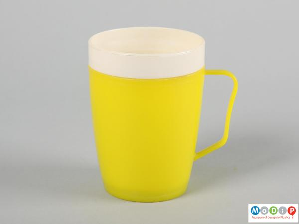Side view of a mug showing the thin handle.