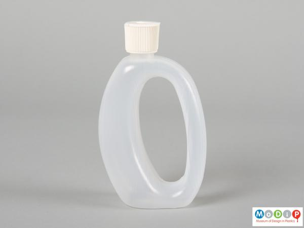 Side view of Runaid bottle showing the whole in the centre forming a handle.