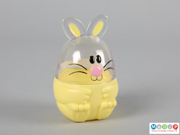 Front view of a Funny Bunny sweet container showing the moulded feet shapes in the base and face in the top section.
