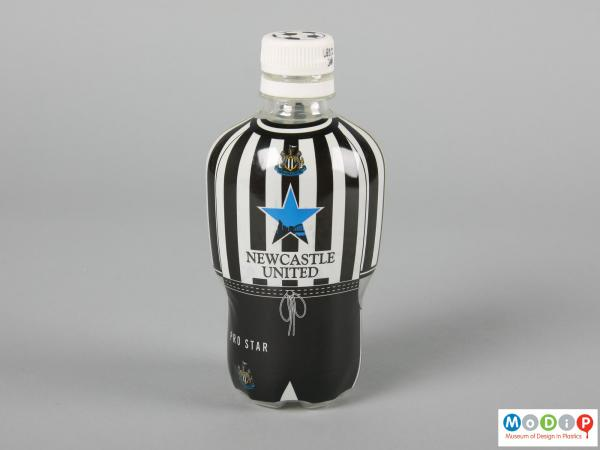 Front view of a football strip bottle showing the white cap and moulded arms.