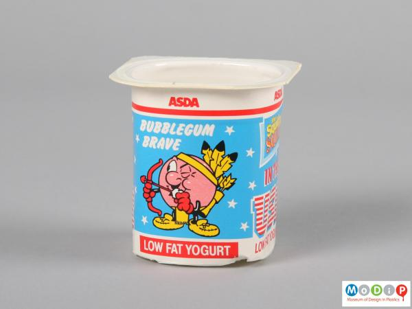 Side view of a yoghurt pot showing the printed label.