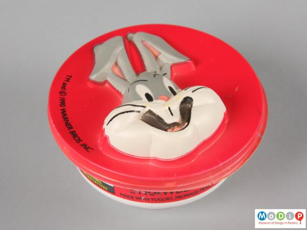Top view of a Bugs Bunny mousse pot showing the vacuum formed face of Bugs Bunny.