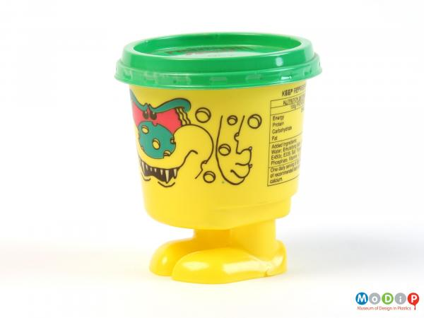 Side view of a Fiendish Feet pot showing the moulded feet and printed features.