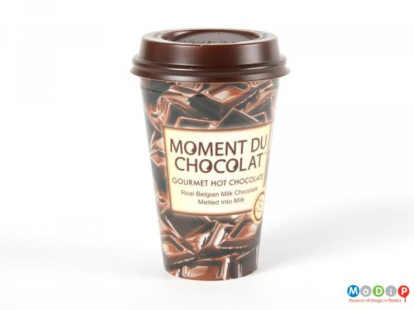 Side view of a Moment Du Chocolat cup showing the tapering shape and printed sides.