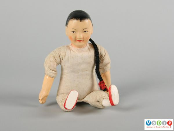 Front view of a doll showing the painted facial features.