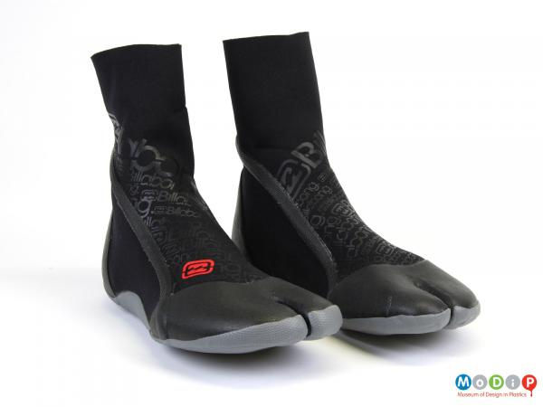 Front view of a pair of surfing boots showing the split toes.