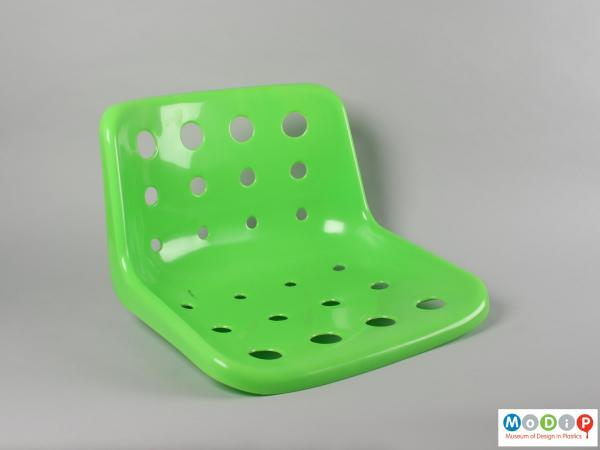 Front view of a seat showing the pattern of holes.