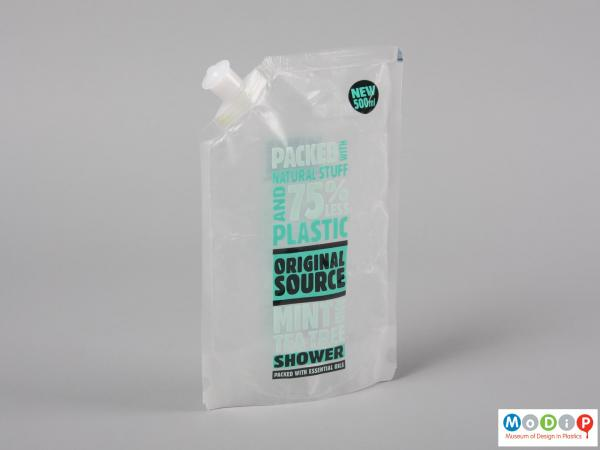 Front view of a shower gel packet showing the spout.