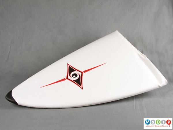 Front view of a surfboard section showing the logo.