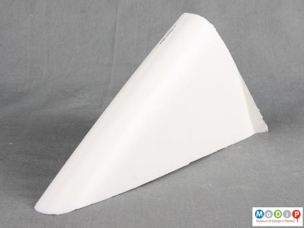 Side view of a surfboard section showing the outer shell.