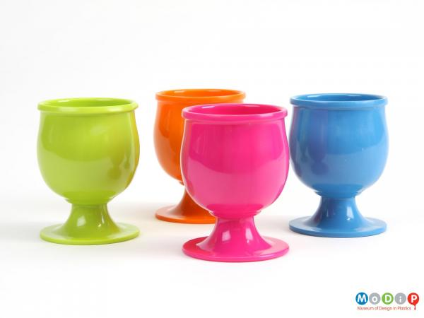 Side view of a set of egg cups showing the fluted plinths.