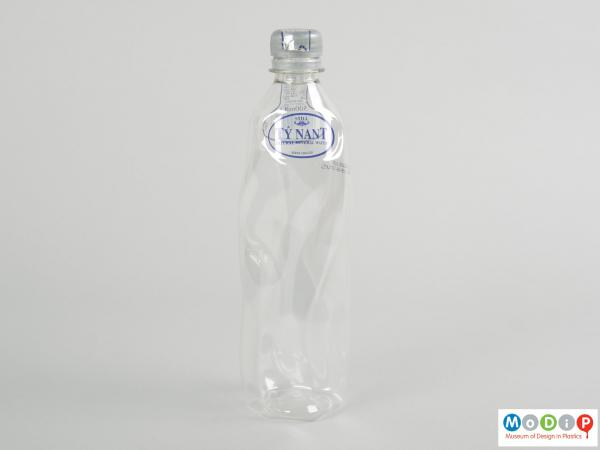 Front view of a bottle showing the contours of the body.